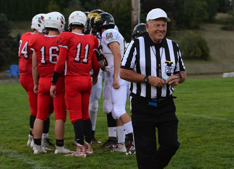 PMG PHOTO: DAVID BALL - John Birkhofer is in his 47th season as a high school football official. He also referees during the prep basketball season.