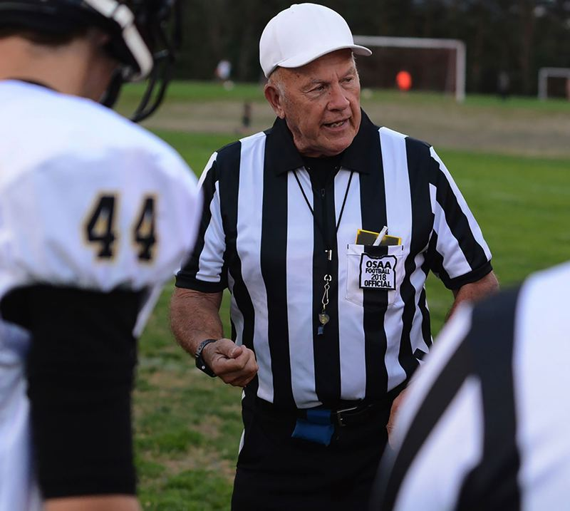 PMG PHOTO: DAVID BALL - East County official John Birkhofer will be tossing the coin as the referee for this years 6A title game — Saturday, Dec. 7, at Hillsboro Stadium.
