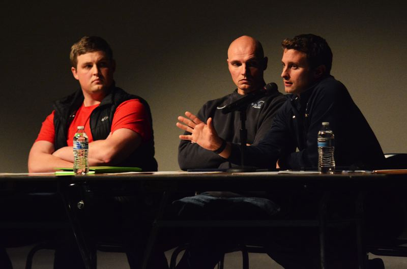 PMG PHOTO: DEREK WILEY - Canby eighth grade football coach Jon Hull, from left, varsity defensive coordinator Brett Rhodes, and athletic director Ben Winegar all spoke of the Cougars possible move to Class 5A during Wednesday's meeting.
