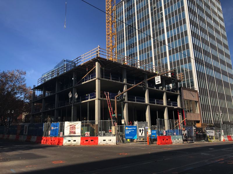 PMG PHOTO: STEPHANIE BASALYGA - The Moxy Hotel is rising on a 7,500-square-foot lot on the corner of Southwest 10th Avenue and Alder that previously held food carts.