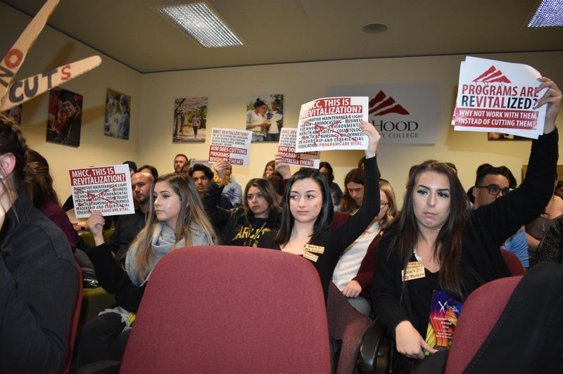 PMG PHOTO: TERESA CARSON - More than 100 people showed up at the Mt. Hood Community College Board of Education meeting Wednesday, Nov. 20, to protest the elmination of seven career programs at the college.