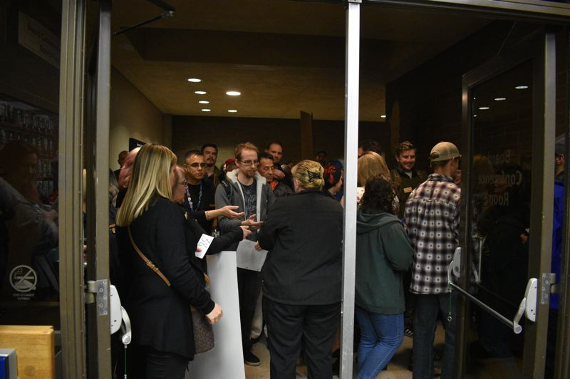 PMG PHOTO: TERESA CARSON - The MHCC board room was not large enough to hold the crowd that showed up to protest the program cuts and many were stuck out in the hall.