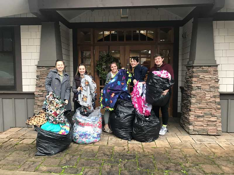 COURTESY PHOTO - Last year's Youth Action Council members delivered about 75 blankets to the Children's Center of Clackamas County.
