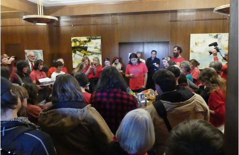 OREGON CAPITAL BUREAU: JAKE THOMAS - Thomas Joseph and dozens of other people jammed into the governor's ceremonial office Thursday, Nov. 21, during a protest of the Jordan Cove liquid natural gas pipeline project.