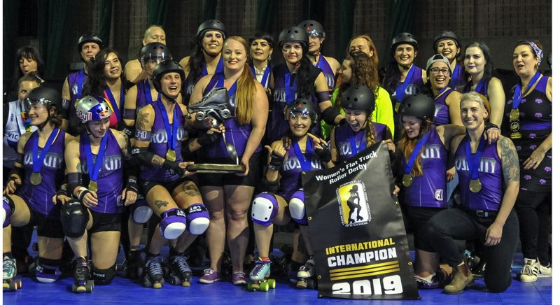 COURTESY PHOTO: CAPOBIANCO PHOTOGRAPHY - Members of the victorious Wheels of Justice (above) celebrate their latest world title with the Hyrda Trophy at the Womens Flat Track Roller Derby championships in Montreal.