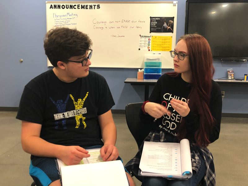 COURTESY PHOTO: JEFFREY SCHROEDER, SAM BARLOW HIGH SCHOOL  - Seniors Bryce Coverdale and and Kellyann Giorgi rehearse American sign language for their respective roles as James Leeds and Sarah Norman in Children of Lesser God at Sam Barlow High School.