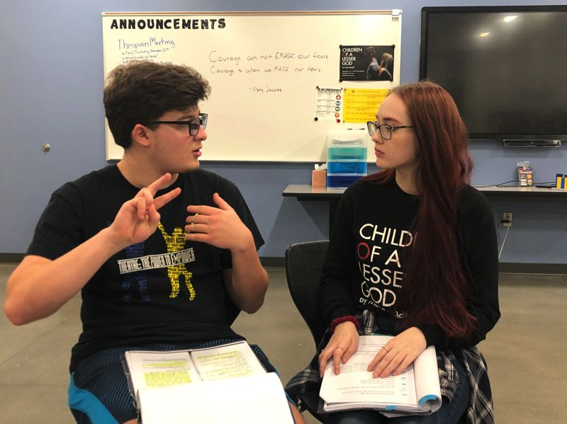 COURTESY PHOTO: JEFFREY SCHROEDER, SAM BARLOW HIGH SCHOOL  - Bryce Coverdale and and Kellyann Giorgi discuss their sign language parts for their seven upcoming performances in Mark Medoffs Lesser God.
