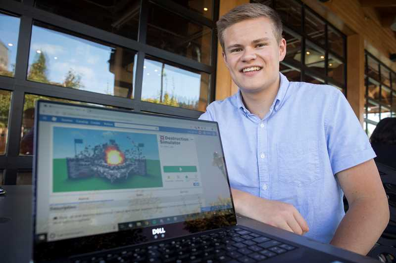 PMG PHOTO: JAIME VALDEZ - Samuel Hofer, a Tigard High School senior, has developed a line of games that have proved so successful, they will pay for his college education. He plans on pursuing studies in computer science, statistics or business.