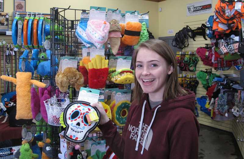 PMG PHOTO: BILL GALLAGHER - Hanna Yeager, sales associate at the Healthy Pets NW store unb MultnomahVillage on SW Troy St. shows off gifts for pets.