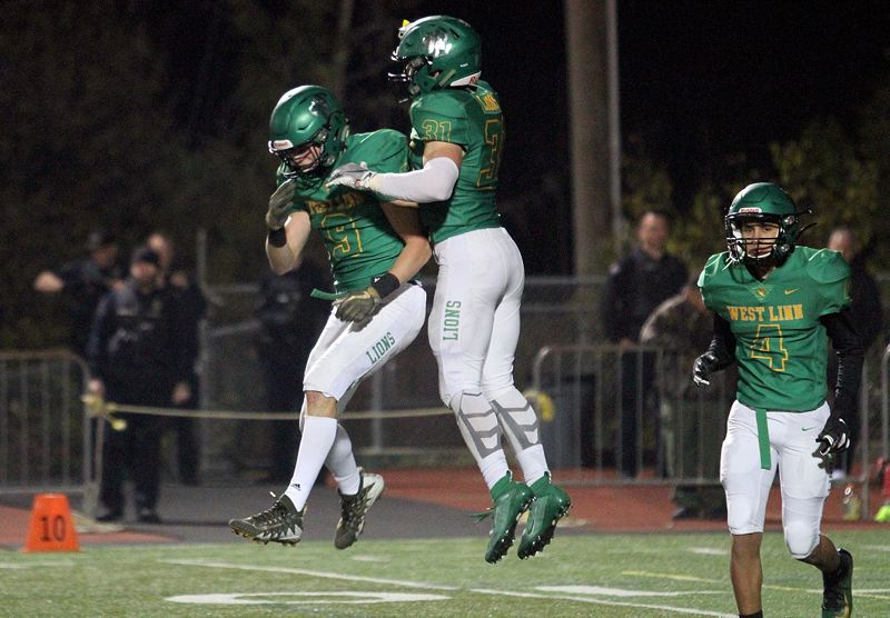 PMG PHOTO: MILES VANCE - West Linn's Clay Masters (left) and Cole Peters gave the Lions plenty of reasons to celebrate in 2019 and hope to add more in their Class 6A state quarterfinal against Central Catholic at Hillsboro Stadium on Friday, Nov. 22.