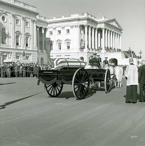 COURTESY ARCHITECT OF THE CAPITOL PHOTOGRAPHERS VIA WIDIMEDIA COMMONS - The United States Marine Band followed the horse-drawn caisson during the Nov. 25, 1963, funeral for John F. Kennedy, shown in this archival photo