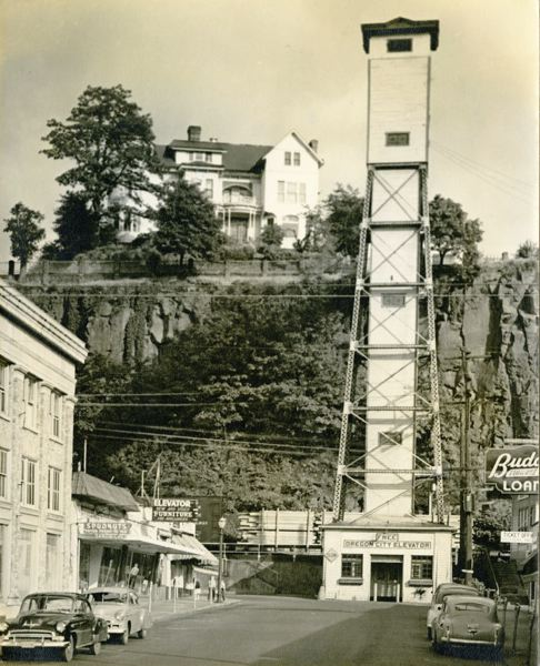 COURTESY PHOTO - In this historic photo, a 'Free Oregon City Elevator' sign hangs over the original Oregon City Municipal Elevator constructed in 1915.