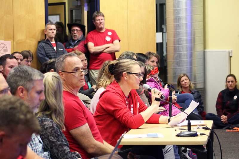 PMG PHOTO: KRISTEN WOHLERS - Canby High School teacher Jennifer Czerkies speaks into the microphone at a board meeting Thursday, Nov. 21 to defend certified staff members' desire for a higher cost-of-living salary adjustment.