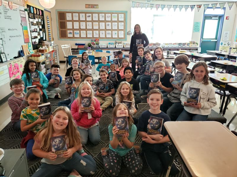 Patti Banka's third graders were excited to use the dictionaries they received from the Gladstone/Oak Lodge Rotary Club.