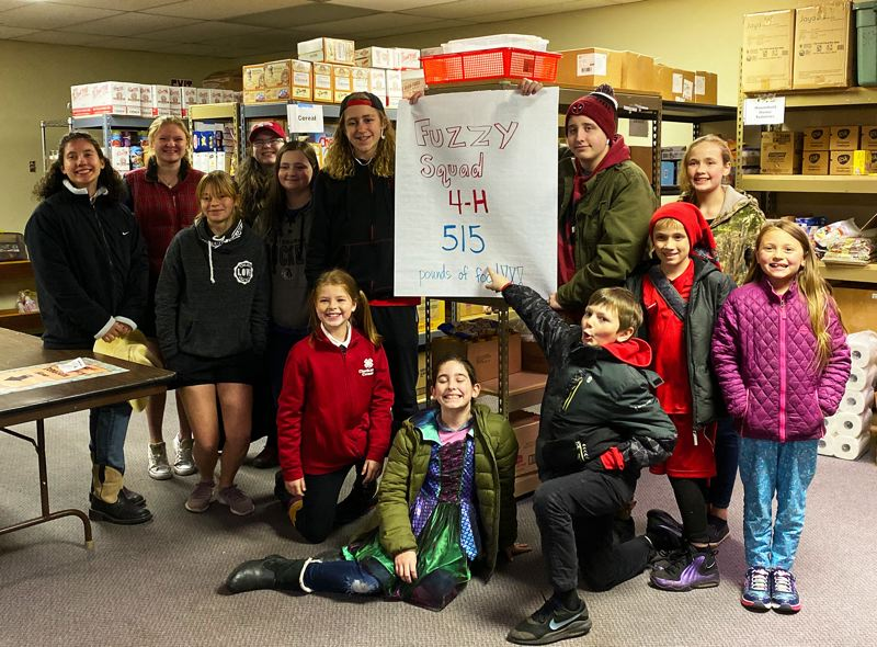 COURTESY PHOTO - The Fuzzy Squad 4-H club conducted a food drive for the Gladstone Food Pantry, donating 515 pounds of food to neighbors in need.