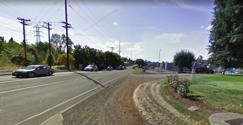COURTESY PHOTO: GOOGLE MAPS - Johnson Creek Boulevard, seen here facing west from Bell Avenue, will be widened to three lanes and will get new bike lanes and a sidewalk.