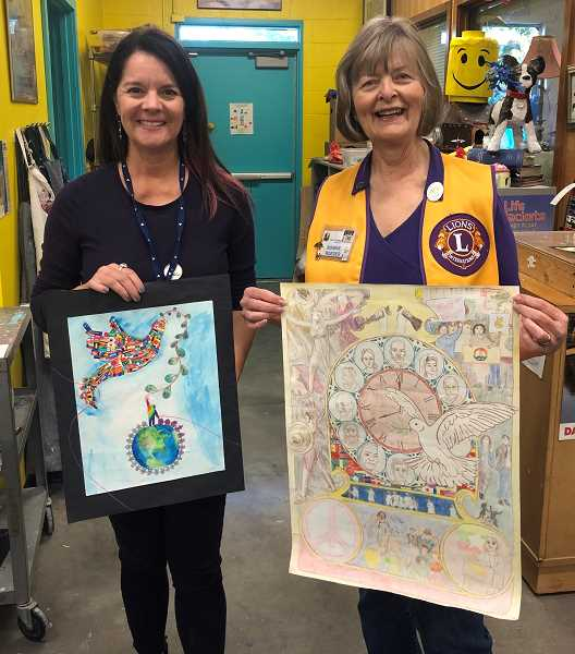 COURTESY PHOTO:  - Pictured are Debora Owen, art teacher at Lake Oswego Junior High, with Bonnie Roeder, chair of the Lake Oswego Lions Club's annual International Peace Poster contest. The women hold the art of local winners Kaitlyn Chun and Jorie Liang.