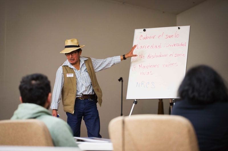COURTESY OF ADELANTE MUJERES - Alejandro Tecum, sustainable agriculture education manager at Adelante Mujeres, teaches during a 12-week course in Spanish about sustainable agriculture.