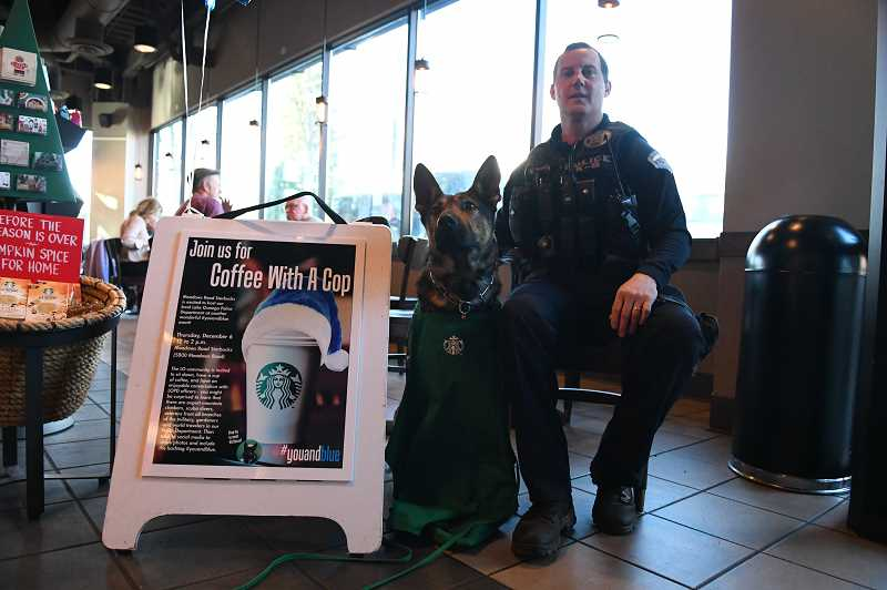 Officer Bryan McMahon poses with K9 Chase at last year's Coffee with a Cop.