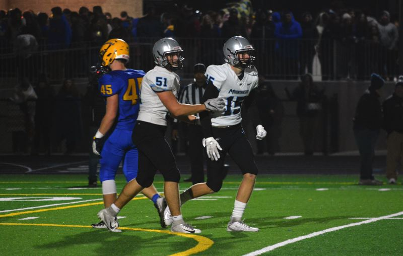 TIMES PHOTO: MATT SINGLEDECKER - Mountainside stars Will Verdine and Parker Groth celebrate a big catch against Barlow.