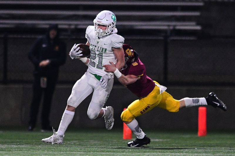 PMG PHOTO: CHRISTOPHER OERTELL - West Linn's Gavin Haines carries the ball during his team's 42-35 loss to Central Catholic in the quarterfinals of the Class 6A state playoffs at Hillsboro Stadium on Friday, Nov. 22.