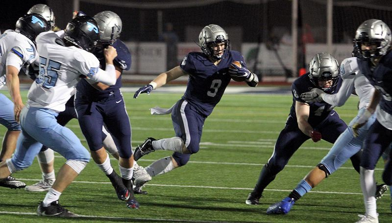 PMG PHOTO: MILES VANCE - Lake Oswego senior running back Casey Filkins rushed 31 times for 225 yards and three touchdowns to help beat Lakeridge 24-21 in the Class 6A state quarterfinals on Friday, Nov. 22, at Lake Oswego High School.