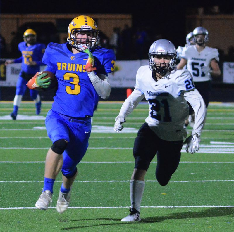 PMG PHOTO: DAVID BALL - Barlow receiver Durham Sundberg turns upfield ahead of Mountainsides Yule Schrock on his way to a 59-yard pass play in the fourth quarter.