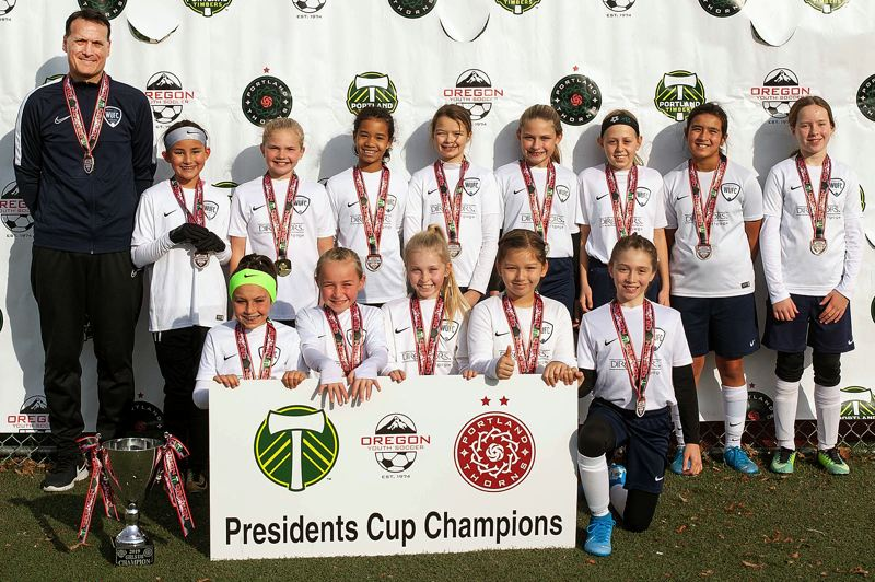 COURTESY PHOTO - The Willamette United Football Club U11 girls team poses with their medals after winning the 2019 Presidents Cup championship.