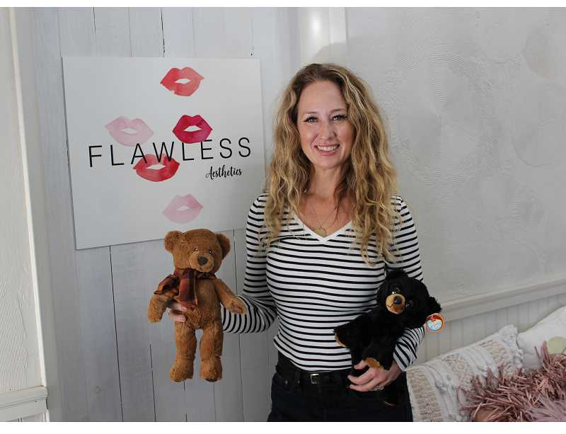 PMG PHOTO: COREY BUCHANAN - Trish Waters, the owners of Flawless Aesthetics, says a teddy bear can give joy to children who were uprooted due to domestic violence.