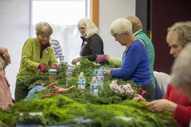 PMG FILE PHOTO - Members of the Wilsonville Garden Club prepare their swags during the 2018 event.