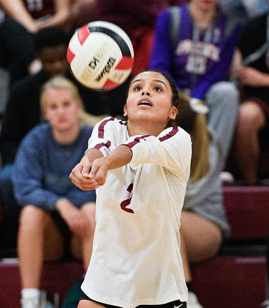 PMG PHOTO: CHRISTOPHER OERTELL - Glencoe's Aneli Godinez-Martines sets up a teammate during a Crimson Tide game this past season. Godinez was a Pacific Conference first team all-league selection.