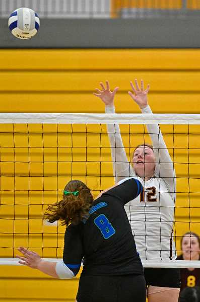 PMG PHOTO: CHRISTOPHER OERTELL - Forest Grove's Olivia Grosse goes up for a block during a Vikings game this past season. Grosse was a Pacific Conference second team all-league selection.
