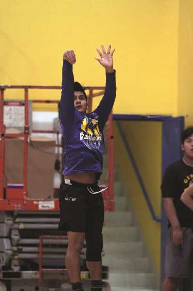 PMG PHOTO: PHIL HAWKINS - Senior guard Daniel Hernandez returns to the boys basketball team after missing last season, giving the Cougars a pass-first floor leader to dictate the teams offense.