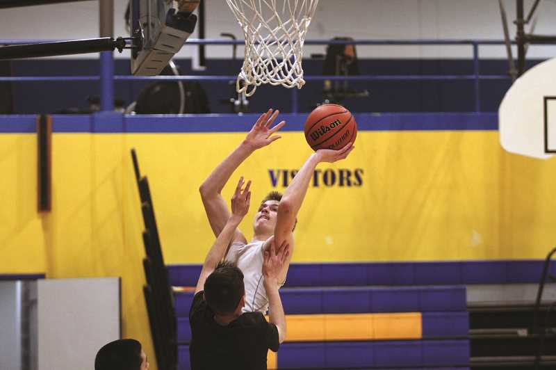 PMG PHOTO: PHIL HAWKINS - Junior wing Michael Toran is one of countless members of the Cougars who stand above 6-feet tall, giving head coach Ben Schultz a variety of defensive options against opposing teams.