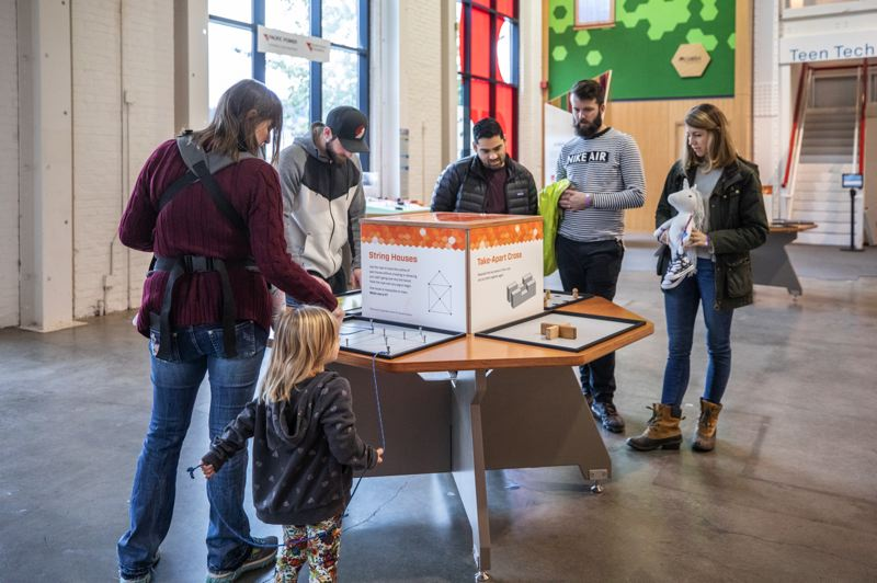 PMG PHOTO: JONATHAN HOUSE - While the renovation of OMSI's Turbine Hall features the new Center for Innovation stations, visitors can still find long-standing favorites such as String Houses and Bottle Rockets.