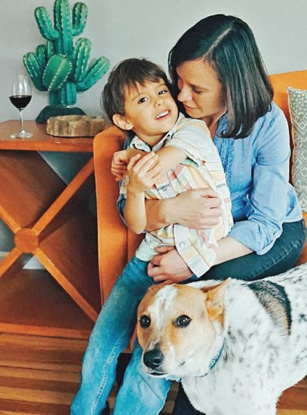 CONTRIBUTED: CRISTINA GONZALES - Cristina Gonzales, seen here with her son, talks about the importance of equal pay efforts, but much more needs to be done.