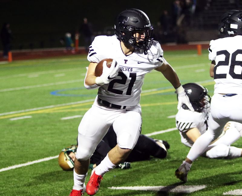 PMG PHOTO: DAN BROOD - Tualatin High School senior Kainoa Sayre, shown here in Friday's state playoff quarterfinal game at Jesuit, ran for 1,283 yards and 30 touchdowns this year, after missing his junior season due to injury.