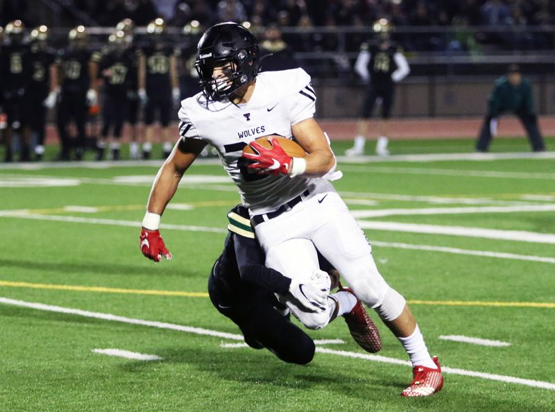 PMG PHOTO: DAN BROOD - Tualatin senior John Miller, shown here during Friday's state playoff quarterfinal game at Jesuit, was the Wolves' leading receiver this year, while also being named the Three Rivers League Defensive Player of the Year.