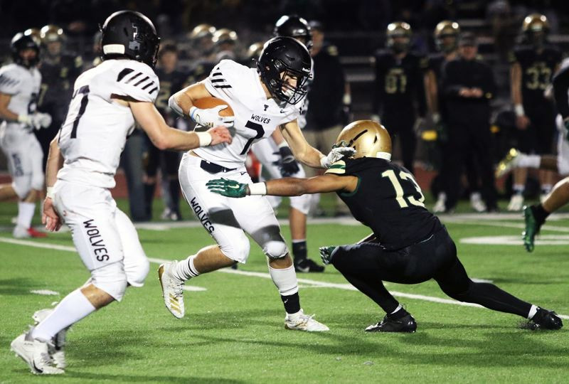 PMG PHOTO: DAN BROOD - Tualatin High School senior Luke Marion had both a 94-yard kickoff return and a 20-yard run for touchdowns during Friday's state playoff quarterfinal game at Jesuit.