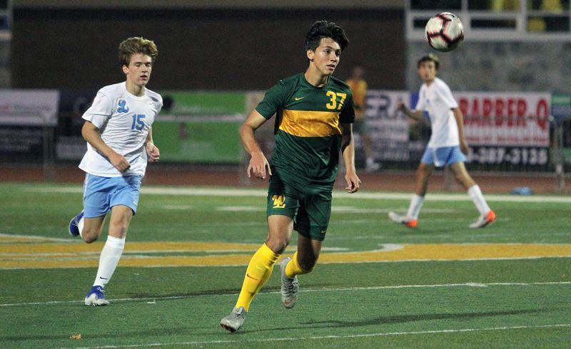 PMG: PHOTO: MILES VANCE - West Linn senior forward Jacob Babalai was rewarded for his strong senior season by being named to the all-Three Rivers League first team in 2019.