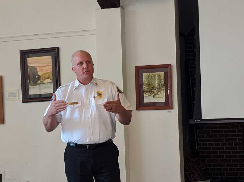 PMG PHOTO: EMILY LINDSTRAND - Clackamas Fire Chief Fred Charlton shares information about the district's contract for service with Estacada during a Chamber of Commerce meeting last week.