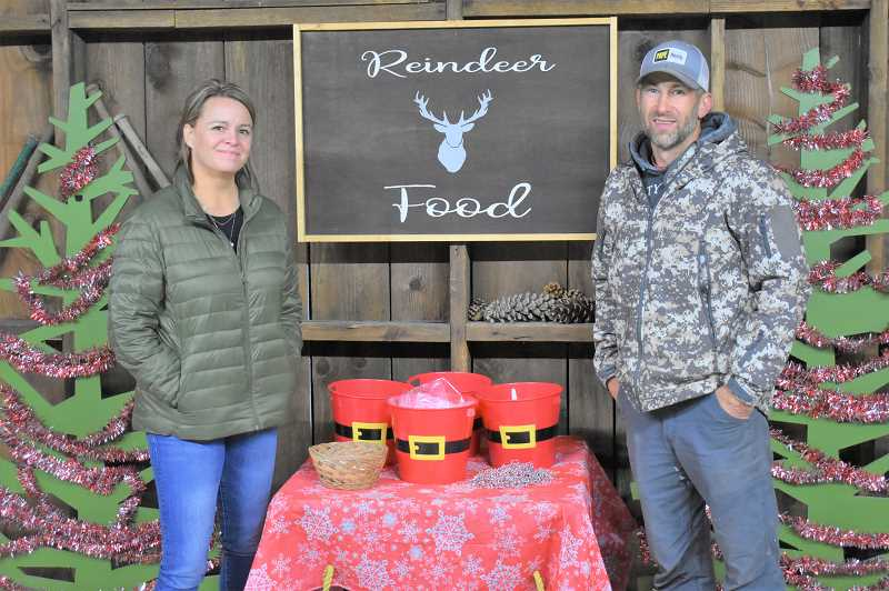 PMG PHOTO: EMILY LINDSTRAND - Chelsea and Jacob Hemphill offer visitors to their farm a festive atmosphere with a variety of childrens activities.
