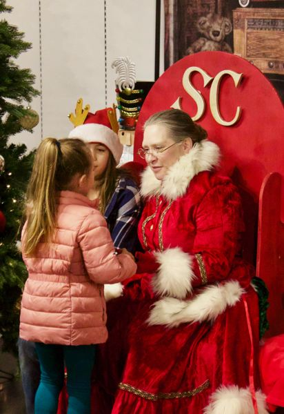 PMG FILE PHOTO - Mrs. Claus is a common sight around the community, including visits to Gresham Station Shopping Centers Merry Mondays.