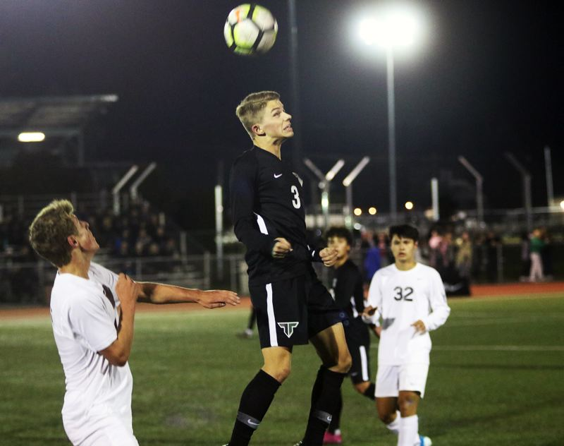 PMG PHOTO: DAN BROOD - Tigard High School senior midfielder Trevor Smith (3) was named the Three Rivers League Player of the Year for the 2019 season.