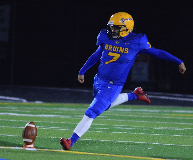 PMG PHOTO: DAVID BALL - Barlow senior Derek Fortanell swings his leg into a kickoff. He took on point-after duties in Fridays quarterfinal game, as well.