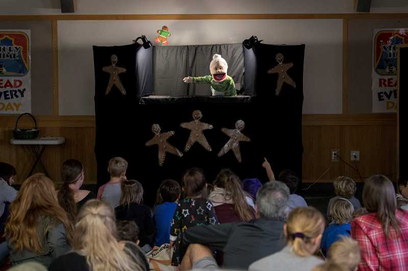 PMG PHOTO: JAIME VALDEZ - Puppets provide entertainment to families at the library.