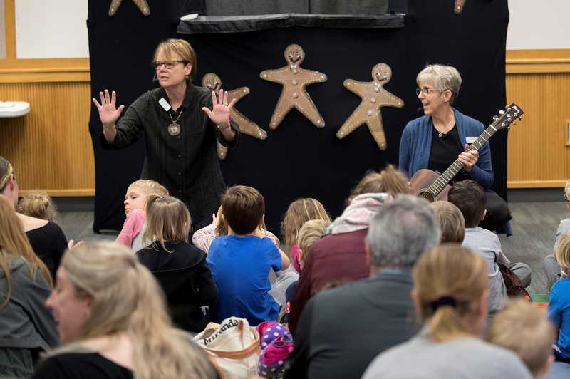 PMG PHOTO: JAIME VALDEZ - Jo Caisse, left, and Terri Workman tell children a tale at the Wilsonville Library.