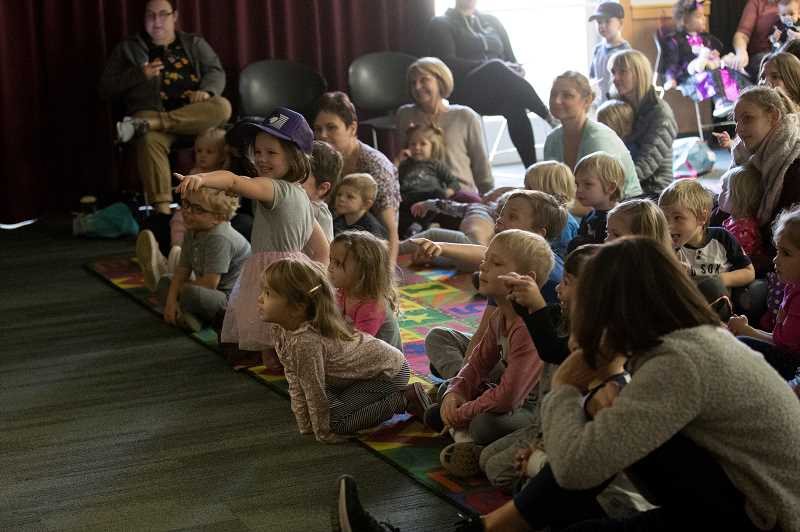 PMG PHOTO: JAIME VALDEZ - Children and their parents are entertained by a puppet show.