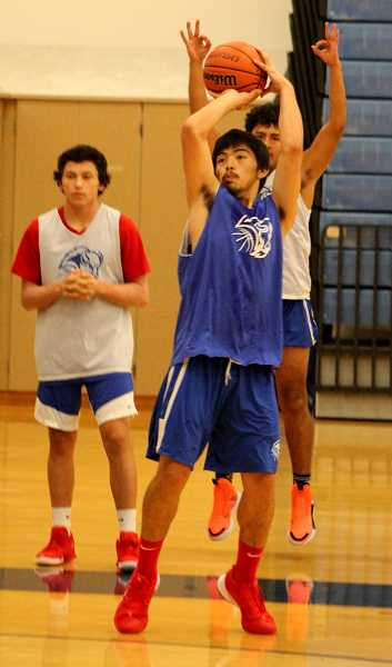 STEELE HAUGEN - Jordan Mitchell takes a 3-pointers during the Buff's first week of practice.