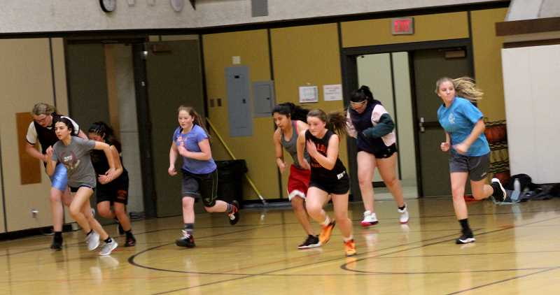 STEELE HAUGEN - Emma Hayes, center, leads the Lady Dawg's basketball team in sprints during the first week of practice. Culver has a home game against the La Pine Hawks at 6 p.m. Wednesday, Dec. 4.